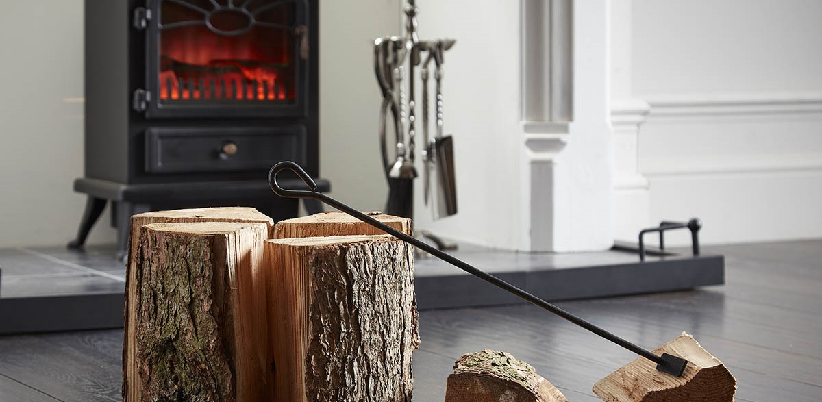 rustic logs in front of a fire place