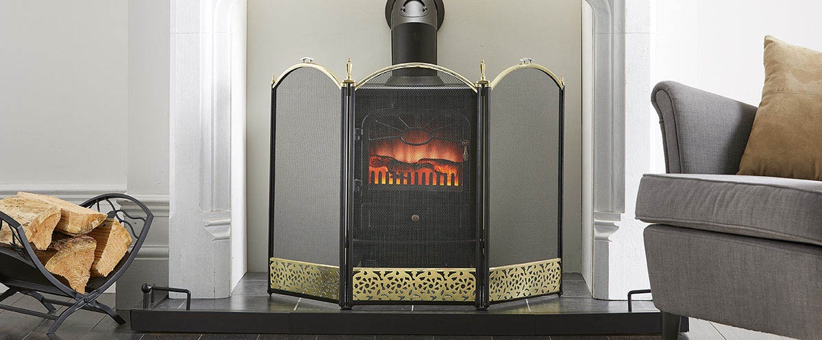 fires surround in front of a fire finished in black and brass
