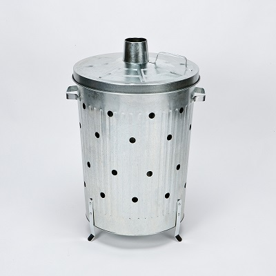 silver galvanised incinerator with breathing holes in the side and small chimney in the lid