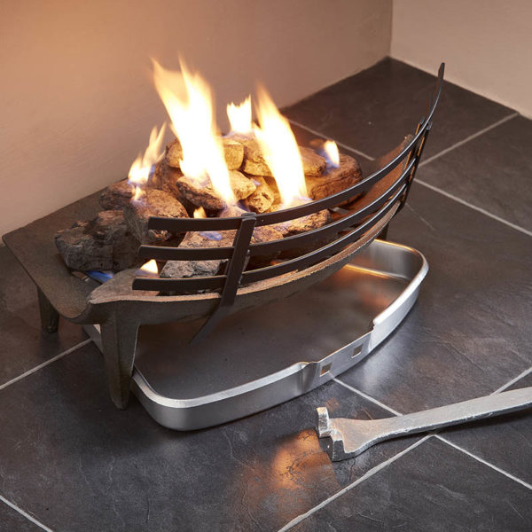 shows a uk wholesale fender and solid fuel set in a fireplace, with yellow flames coming from the coal