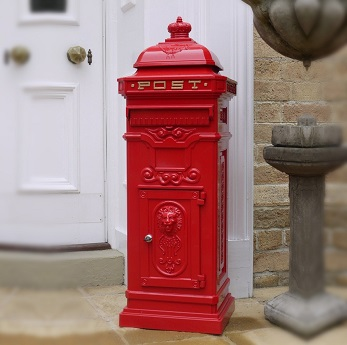 wholesale post box with a victorian style stands outside a house with a white door