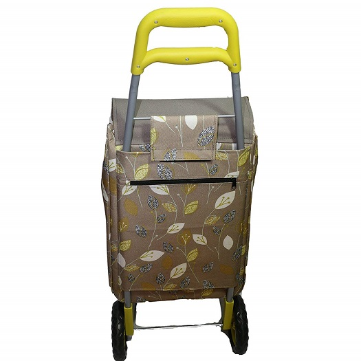A green wheeled shopping trolly with a leaf design fabric and a yellow drag handle